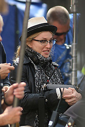 ©London News Pictures. 15/01/2011 .Picture Credit Should read Neil Hall/London News Pictures.Madonna directs her new period film W.E. starring Abbie Cornish about the abdication of King Edward in London on 08/08/2010. Madonna views playback footage of a take
