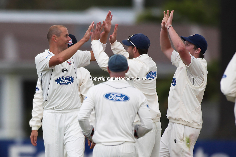 Auckland's Chris Martin celebtares the wicket of Matt Sinclair in the Plunket Shield cricket match between the Central Districts Stags and the Auckland Aces at Nelson Park, Napier,  New Zealand. Sunday, 04 November, 2012. Photo: John Cowpland / photosport.co.nz