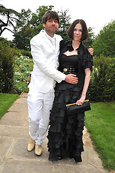 ALEX JAMES and his wife CLARE at the Raisa Gorbachev Foundation fourth annual fundraising gala dinner held at Stud House, Hampton Court, Surrey on 6th June 2009.