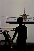 A young boys plays with a display featuring an airliner at the Mitsubishi Minatomirai Industrial Museum, Sakuraguicho, Yokohama, Japan. Saturday. December 28th 2013