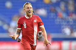 July 7, 2017 - Harrison, New Jersey, U.S - Canada midfielder SCOTT ARFIELD (8) celebrates his goal during CONCACAF Gold Cup 2017 action at Red Bull Arena in Harrison New Jersey Canada defeats French Guiana 4 to 2. (Credit Image: © Brooks Von Arx via ZUMA Wire)