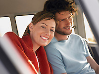 Couple sitting in front seat of van close up