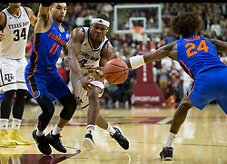 Texas A&M guard JJ Caldwell (4) has the ball knocked away by Florida guard Deaundrae Ballard (24) as he tries top drive the lane against Florida guard Chris Chiozza (11) during the first half of an NCAA college basketball game Tuesday, Jan. 2, 2018, in College Station, Texas. (AP Photo/Sam Craft)
