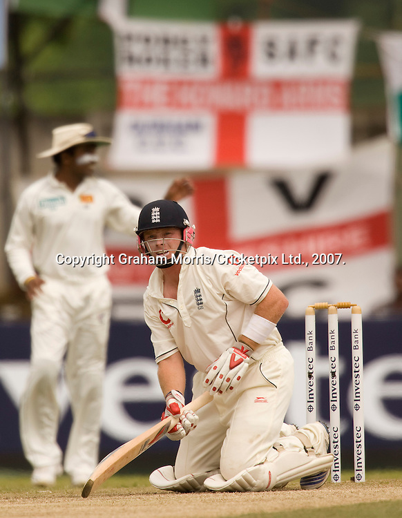 Ian Bell is brought to his knees by a ball from Dilhara Fernando during the first Test Match between Sri Lanka and England at the Asgiriya Stadium, Kandy. Photograph © Graham Morris/cricketpix.com (Tel: +44 (0)20 8969 4192; Email: sales@cricketpix.com)