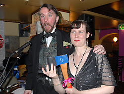 Picture by Mark Larner. Picture shows The New Sheridan Club Christmas Party. December 2007. At the murder-mystery themed evening Miss Minna wins a hatchet.