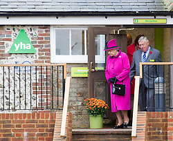 NEWHAVEN- UK - 31-OCT-2013: Britain's Queen Elizabeth accompanied by HRH The Duke of Edinburgh visit YHA (Youth Hostel Association) South Downs where they toured the newly refurbished facilities viewing the new 'Glamping pods.' Glamorous camping podsThey will meet staff and Duke of Edinburgh Award students staying at the centre before unveiling a plaque to mark the opening of the new facility<br /> Photograph by Ian Jones