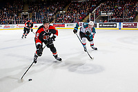 KELOWNA, CANADA - JANUARY 30: Nolan Foote #29 of the Kelowna Rockets checks Dylan MacPherson #6 of the Medicine Hat Tigers as he skates with the puck during first period on January 30, 2017 at Prospera Place in Kelowna, British Columbia, Canada.  (Photo by Marissa Baecker/Shoot the Breeze)  *** Local Caption ***
