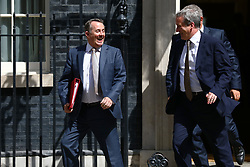 © Licensed to London News Pictures. 17/07/2018. London, UK. Secretary of State for International Trade Liam Fox (L) and Education Secretary Damian Hinds (R) leave 10 Downing Street after the Cabinet meeting. Photo credit: Rob Pinney/LNP