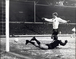 Dec. 07, 1967 - International Football at Wembley. England and Russia Draw 2-2. Photo Shows: Alan Ball seen scoring England's first goal, with Russian Gaolkeeper Psenitchnikov, on the ground during last night's International soccer match at Wembley which resulted in a 2-2 draw. (Credit Image: © Keystone Press Agency/Keystone USA via ZUMAPRESS.com)