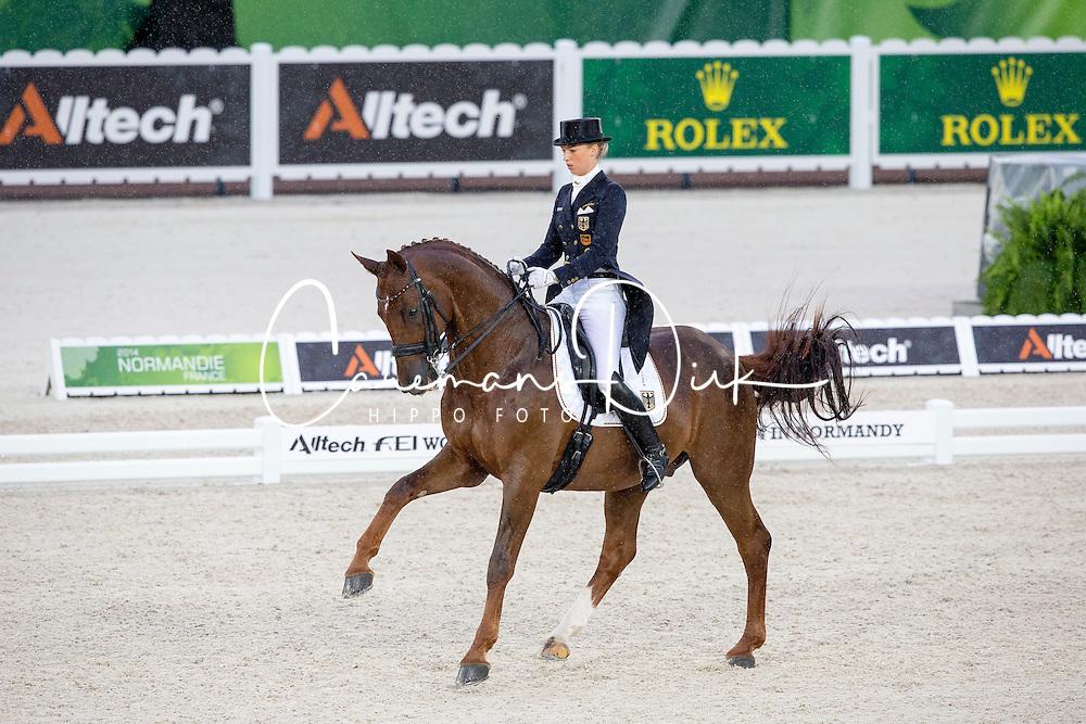 Fabienne Lutkemeier, (GER), D'Agostino FRH - Grand Prix Team Competition Dressage - Alltech FEI World Equestrian Games™ 2014 - Normandy, France.<br /> © Hippo Foto Team - Leanjo de Koster<br /> 25/06/14
