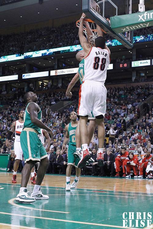 09 March 2012:  Portland Trailblazers forward Nicolas Batum (88) dunks over Boston Celtics small forward Sasha Pavlovic (11) during the Boston Celtics 104-86 victory over the Portland Trail Blazers at the TD Banknorth Garden, Boston, Massachusetts, USA.