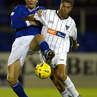 St Johnstone v Dunfermline..CIS Cup..28.10.03<br />Darren Dods puts in a tackle on Craig Brewster<br /><br />Picture by Graeme Hart.<br />Copyright Perthshire Picture Agency<br />Tel: 01738 623350  Mobile: 07990 594431