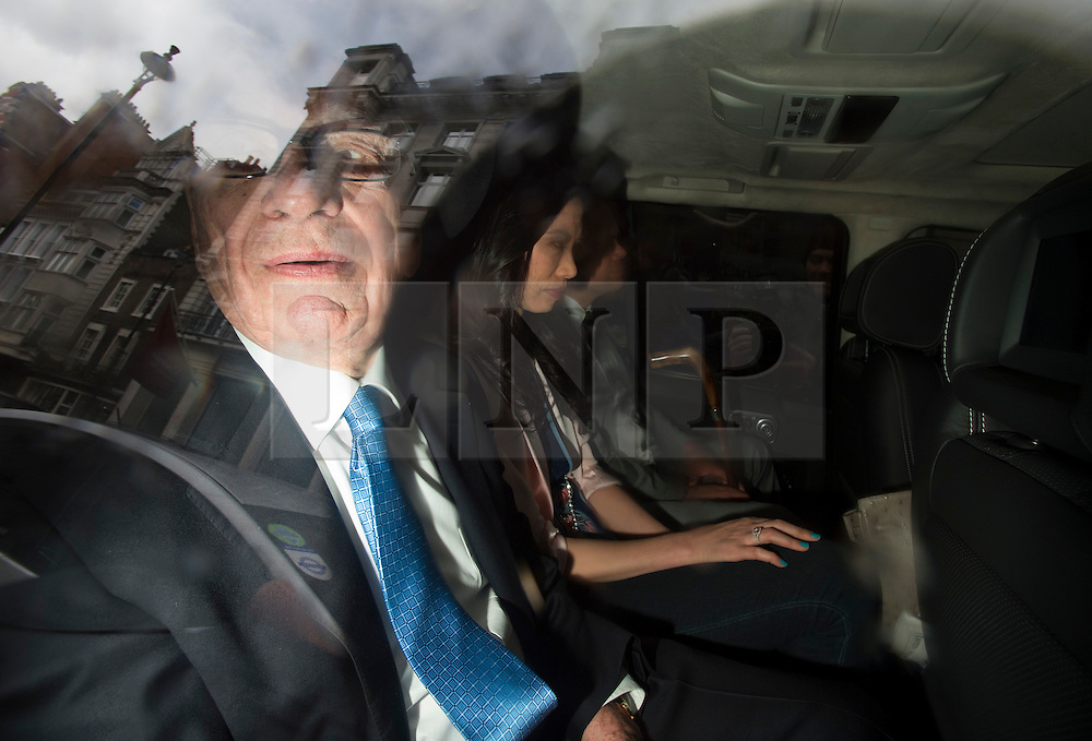© London News Pictures. 26/04/2012. London, UK. Rupert Murdoch (left)  being driven from The High Court in London with his wife Wendy Deng Murdoch and son Lachlan, on April 26, 2012 after giving evidence to the Leveson inquiry.  Photo credit : Ben Cawthra /LNP