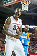 FAYETTEVILLE, AR - NOVEMBER 13:  Moses Kingsley #33 of the Arkansas Razorbacks screams after dunking the basketball during a game against the Southern University Jaguars at Bud Walton Arena on November 13, 2015 in Fayetteville, Arkansas.  The Razorbacks defeated the Jaguars 86-68.  (Photo by Wesley Hitt/Getty Images) *** Local Caption *** Moses Kingsley