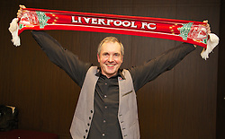 MELBOURNE, AUSTRALIA - Monday, July 22, 2013: Liverpool supporter, actor Alan Fletcher, who plays Dr. Karl Kennedy in the Australian soap Neighbours, poses with a Liverpool scar at the Anfield Wrap gig at the Melbourne Hilton Hotel. (Pic by David Rawcliffe/Propaganda)