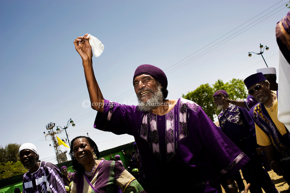 Ben Ami Ben Israel (C), founder and spiritual leader of the Kingdom on Yah waves on May 26, 2010, along with members of the Hebrew Israelite community attending Passover holiday celebrations to mark the 42nd anniversary of their arrival to Israel, in the southern Israeli town of Dimona. The holiday commemorates the day they left Chicago for Liberia before moving to the Holy Land. The community, which approximately includes 2000 members, arrived in Israel in 1969 and has since then maintained a vibrant culture which includes a communal lifestyle and a vegan diet. Hebrew Israelites believe in the Torah and in polygamy. © ALESSIO ROMENZI