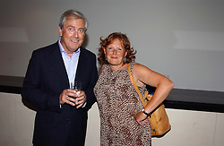 MR GYLES BRANDRETH and MRS BERNARD JENKIN at the Conservative party Pre-Conference Season party hosted by Lord Saatchi and Lord Strathclyde and held at M&C Saatchi, 36 Golden Square, London W1 on 7th September 2004.