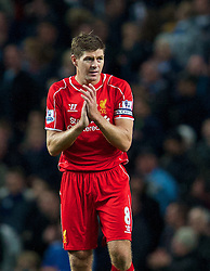 MANCHESTER, ENGLAND - Monday, August 25, 2014: Liverpool's captain Steven Gerrard looks dejected as Manchester City score the second goal during the Premier League match at the City of Manchester Stadium. (Pic by David Rawcliffe/Propaganda)