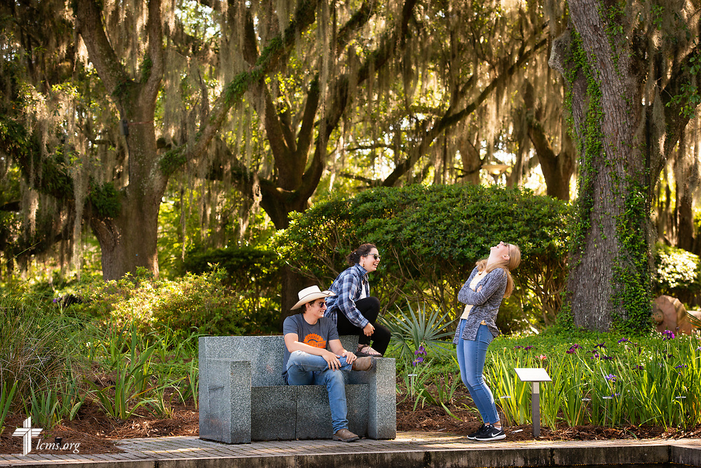 Young Adult Corps participants (left to right) Hayden Duncan, Madison Ezzell, and Courtney Haag share a moment together as they browse the Sydney and Walda Besthoff Sculpture Garden at the New Orleans Museum of Art during some free time before evening worship on Wednesday, April 4, 2018, in New Orleans. LCMS Communications/Erik M. Lunsford
