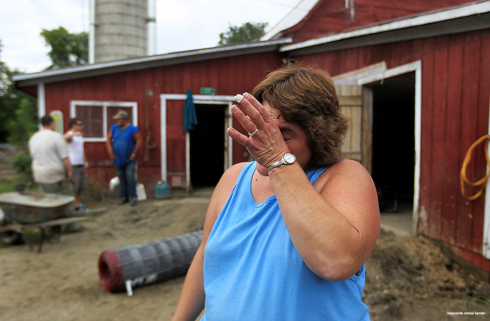 Overwhelmed by the devastation caused by hurricane Irene, and acts of kindness from total strangers, Penny Severance, owner of Perley Farm in Royalton, VT, weeps, Friday, Sept. 2, 2011 .  (Cheryl Senter for the New York Times)