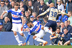 QPR's Armand Traore and Leeds United's Jimmy Kebe  - Photo mandatory by-line: Mitchell Gunn/JMP - Tel: Mobile: 07966 386802 01/03/2014 - SPORT - FOOTBALL - Loftus Road - London - Queens Park Rangers v Leeds United - Championship