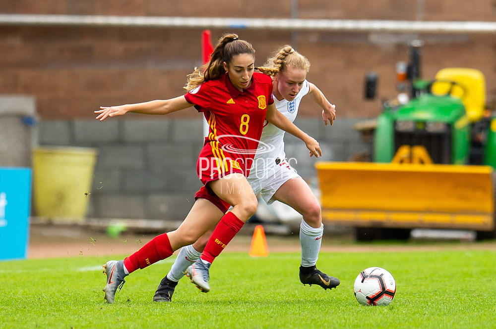 Lucy Fitzgerald (#7) of England tussles with Olga Carmona (#8) of Spain during the UEFA Women's U19 European Championship match between England Women and Spain at Forthbank Stadium, Stirling, Scotland on 19 July 2019.
