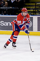 KELOWNA, CANADA, DECEMBER 27: Steve Kuhn #20 of the Spokane Chiefs skates with the puck at the Kelowna Rockets on December 7, 2011 at Prospera Place in Kelowna, British Columbia, Canada (Photo by Marissa Baecker/Getty Images) *** Local Caption ***