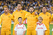 March 28 2017: Socceroos Mathew LECKIE (7), Socceroos Tomi JURIC (9), Socceroos Mark MILLIGAN (5) and Socceroos James TROISI (14) sing the national anthem at the 2018 FIFA World Cup Qualification match, between The Socceroos and UAE played at Allianz Stadium in Sydney.