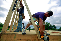 23 August 2013. Lower 9th Ward, New Orleans, Louisiana.<br /> Katrina 8 years later. In a tale of two cities, the hardest hit neighbourhoods struggle to revitalize and return. R/L; Josh Gillikin and David Rosa, contractors working for Brimmer Construction Services begin the extensive process of rebuilding a formerly derelict house. Many half finished or blighted properties and vacant overgrown lots remain dotted throughout the landscape. Residents who have returned complain of limited services, infrequent police patrols, high crime rates, rampant mosquitos and uncontrolled vermin. <br /> Photo; Charlie Varley