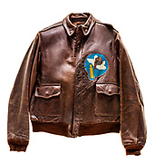 "This type A2 flight jacket was worn by John G. Stanley, a tail gunner on the ""Diplomat"". The 569th squadron patch is attached to the front of the jacket, and the name ""Diplomat"" above a swastika and a B-17 is painted on the back. Each bomb painted on the jacket signifies a successful mission. The ""Diplomat"" was WIA (wounded in action) while flying a mission on December 24, 1944, and was declared salvage on February 6, 1945."