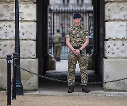 © Licensed to London News Pictures. 16/09/2017. London, UK. An entrance to Horse Guards, normally open to the public, closed and guarded by soldiers the day after a bomb partly exploded on a tube train at Parsons Green station in London injuring members of the public. Operation temperer has been put in to place after the UK terror threat level was raised to critical. Photo credit: Ben Cawthra/LNP
