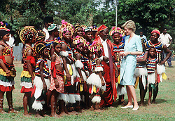 Diana, Princess of Wales, meets a tribe in traditional dress during a tour of Nigeria in March, 1990.