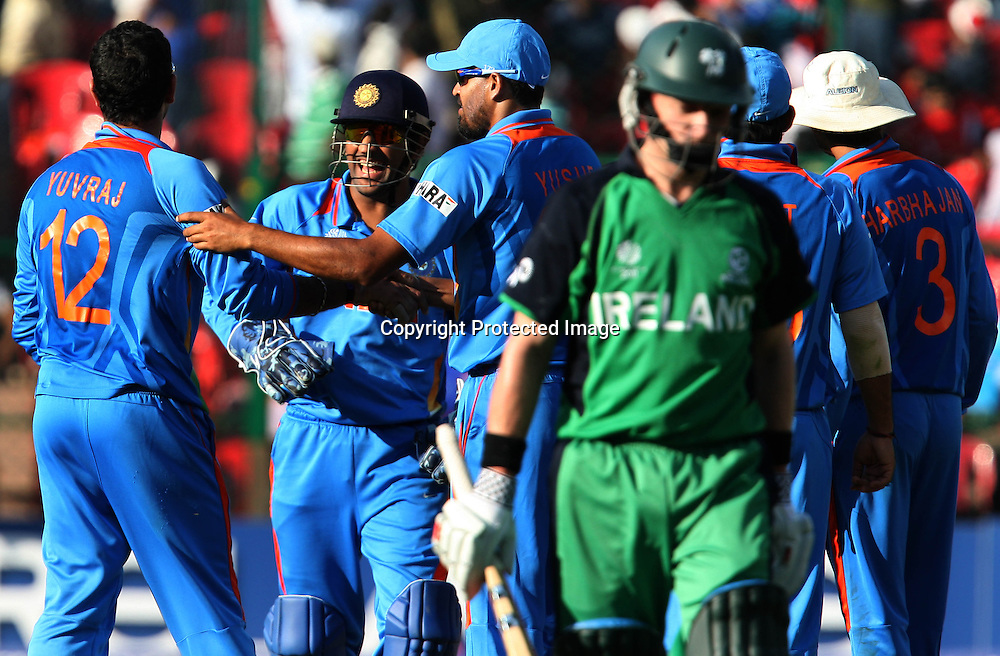 Indian player Yuvraj Singh celebrates with team mates Ireland batsman William Porterfield wicket during the ICC Cricket World Cup - 22nd Match, Group B, India vs Ireland Played at M Chinnaswamy Stadium, Bangalore, 6 March 2011 - day/night (50-over match)