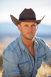 portrait of a good looking blue eyed cowboy
