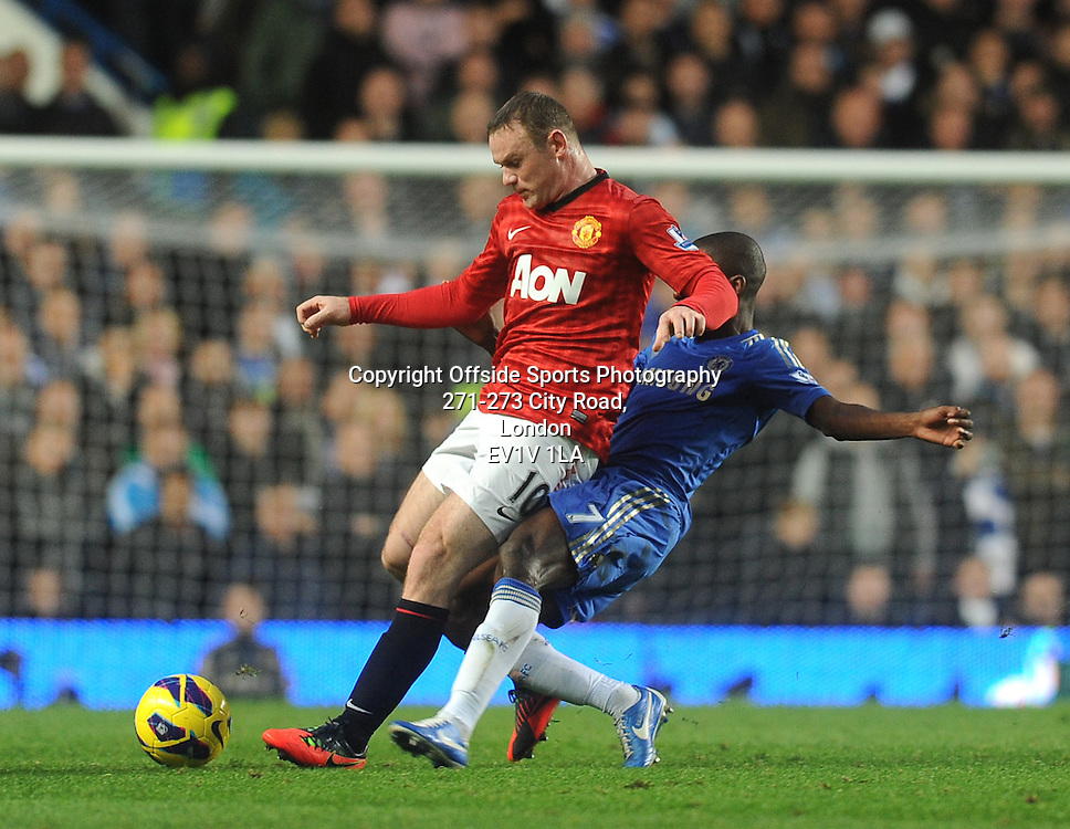 28/10/2012 - Barclays Premier League Football - 2012-2013 - Chelsea v Manchester United - Wayne Rooney of United holds off Ramires of Chelsea. - Photo: Charlie Crowhurst / Offside.