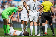 Meikayla Moore (New Zealand) injured talking with Erin Nayler (GK)(New Zealand) looked on by Rebekah Stott (New Zealand) and Monika Mularczyk Referee  during the FIFA Women's World Cup UEFA warm up match between England Women and New Zealand Women at the American Express Community Stadium, Brighton and Hove, England on 1 June 2019.