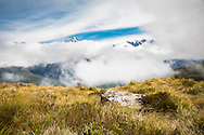 Mountain peaks rising above the clouds, Routeburn Track, South Island, New Zealand