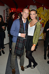 CARLO CARELLO and PHOEBE WATSON at a party to celebrate the first anniversary of SushiSamba at the Heron Tower, 110 Bishopsgate, London EC4 on 12th November 2013.