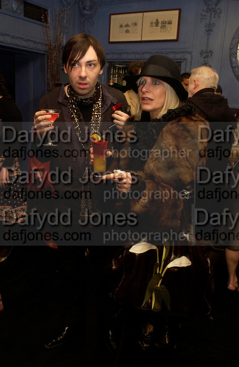 James Long and Nancy Bates. Zac Posen Spring/ Summer collection launch party. The Blue Bar, Berkeley Hotel. London. 7 March 2004. Dafydd Jones,  ONE TIME USE ONLY - DO NOT ARCHIVE  © Copyright Photograph by Dafydd Jones 66 Stockwell Park Rd. London SW9 0DA Tel 020 7733 0108 www.dafjones.com