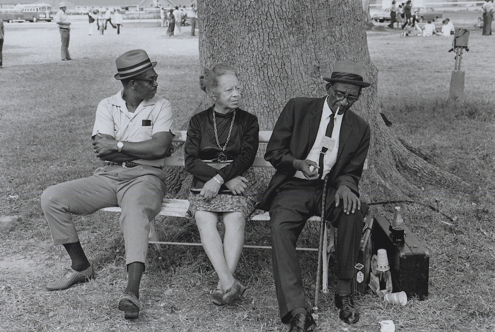 Spectators and participants of the third Louisiana Jazz and Heritage Festival in New Orleans take a break and have a drink.