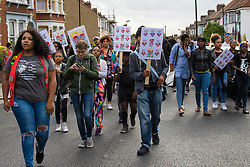 Tottenham, London, August 4th 2015. Family, friends and supporters of alleged gangster Mark Duggan, who was shot and killed by police on 4th August 2011 in Tottenham, commemorate his death which led to widespread uprisings and riots, by marching from Broadwater Farm estate to Tottenham police station. His family is demanding a public inquiry into the role of Operation Trident, set up to fight gun and knife crime amongst the black community, whose officers they accuse of putting guns out on the streets of London.   // Contact: paul@pauldaveycreative.co.uk Mobile 07966 016 296