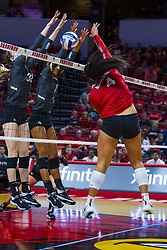 BLOOMINGTON, IL - September 14: Kaylee Martin powers the ball over the net at Anne-Marie Watson and Nerissa Moravec during a college Women's volleyball match between the ISU Redbirds and the University of Central Florida (UCF) Knights on September 14 2019 at Illinois State University in Normal, IL. (Photo by Alan Look)