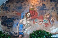 Alessano (Lecce) - Particolare di un affresco rappresentante la deposizione di Gesù dalla Croce e l'accoglimento del corpo da parte della Madonna. L'affresco è situato sotto l'ingresso della Chiesa della Madonna del Buon Riposo (Secolo XIX), situata sopra una piccola altura da cui si domina il paese di Alessano.