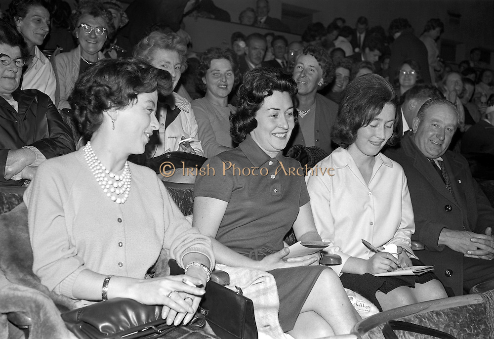 """Gael Linn Bingo..1963..03.10.1963..10.03.1963..3rd October 1963..Gael Linn bingo took place in Whitehall Cinema last night, it set a record when Mrs Kathleen Sperrin from Swords Road, Dublin filled a line in only 8 calls. This achievement completed in a time of only 30 seconds won a bonus prize of £100 for Mrs Sperrin in addition to the ordinary prize...""""Eyes Down"""" this mostly female audience are pictured preparing for the next game on their bingo cards."""