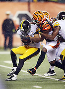 Pittsburgh Steelers defensive back Ross Cockrell (31) gets tackled by Cincinnati Bengals wide receiver A.J. Green (18) after Cockrell recovers a fumble after Pittsburgh Steelers outside linebacker Jarvis Jones (95) and Pittsburgh Steelers inside linebacker Ryan Shazier (50) strip the ball from Cincinnati Bengals running back Jeremy Hill (32) on a late fourth quarter play in which Hill fumbles, leading to the Steelers dramatic comeback win, during the NFL AFC Wild Card playoff football game against the Pittsburgh Steelers on Saturday, Jan. 9, 2016 in Cincinnati. The Steelers won the game 18-16. (©Paul Anthony Spinelli)