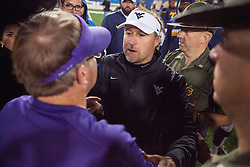 Oct 22, 2016; Morgantown, WV, USA; West Virginia Mountaineers head coach Dana Holgorsen speaks with TCU Horned Frogs head coach Gary Patterson after the game at Milan Puskar Stadium. Mandatory Credit: Ben Queen-USA TODAY Sports