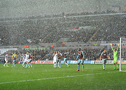Players from both team wait for a corner in the driving rain - Photo mandatory by-line: Joe Meredith/JMP - Tel: Mobile: 07966 386802 27/10/2013 - SPORT - FOOTBALL - Liberty Stadium - Swansea - Swansea City v West Ham United - Barclays Premier League