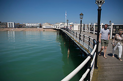 © Licensed to London News Pictures. 05/05/2018. Worthing, UK. The sea appears green, viewed from the pier, in the sunshine at Worthing, West Sussex. Record temperatures are expected this bank holiday weekend. Photo credit: Peter Macdiarmid/LNP