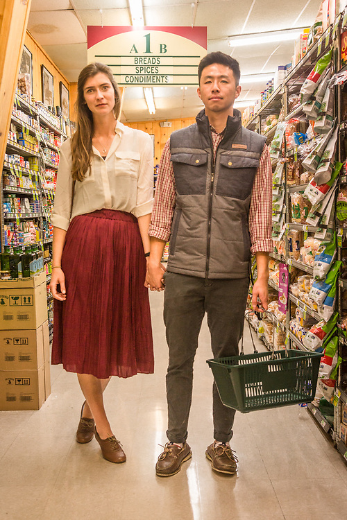 """""""Jon surprised me with a trip to wine country, but we are students, so we're here hoping to find an inexpensive bottle of wine.""""  -First year medical students Alex Murdock and Jonathan Liu shop at the CalMart in Calistoga."""