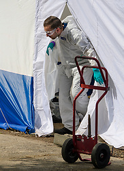 © Licensed to London News Pictures. 16/05/2017. London, UK. Police forensics leave a tent at the scene where a search continues for the body of murdered schoolgirl Danielle Jones at a block of garages in Stifford Clays in Thurrock, Essex. The 15-year-old was last seen on Monday June 18 2001 at about 8am when she left her home in East Tilbury to catch the bus to school.  Photo credit: Ben Cawthra/LNP